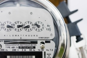 Close-up of an electric meter with lock in background.